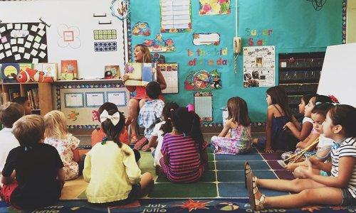 stock-photo-education-learning-reading-school-kids-classroom-storybook-teacher-kindergarten-a50f2cd0-e07b-47cd-ae35-e93365f6b66f